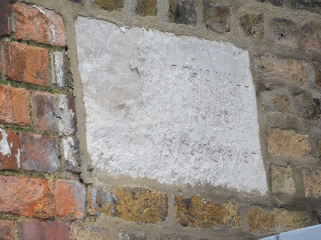 Unreadable stone on the end wall of 1 Reveley Almshouses. Feb 2017 | Colin Wilson